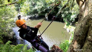 Our mountain guide setting up a zip-line, canyoning the Reunion Island
