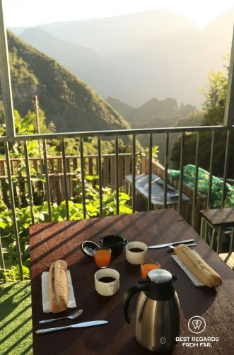 A French breakfast with baguette, coffee and fruit juice at the Gîte de Bellevue in Mafate amphitheater, overlooking the mountains of Réunion Island.