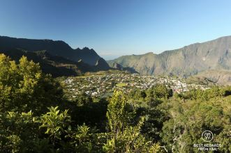 View on the city of Cilaos on the exclusive multiday hike through the 3 cirques, Réunion Island.