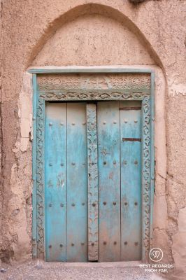 Typical wood carved door in Al Hamra, Oman