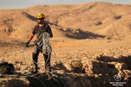 The expert caving guide Justin Hall all geared up and ensuring safety on the Selma Plateau during the Seventh Hole caving expedition in Oman.
