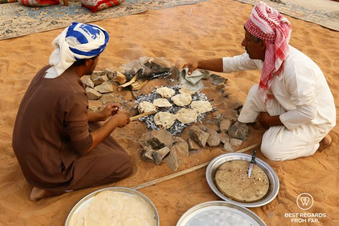 Baking Gursh, the traditional Bedouin bread in the desert, Oman