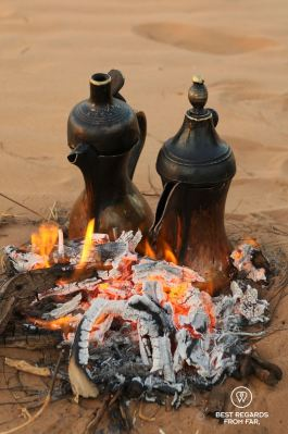 Brewing traditional Omani coffee in the desert