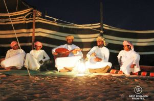 Traditional Bedouin music at night in the desert, Oman