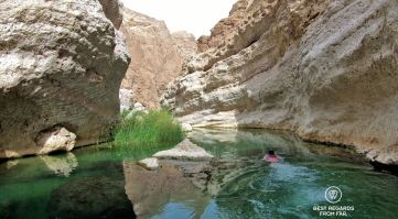 Swimming through Wadi Shab, Oman