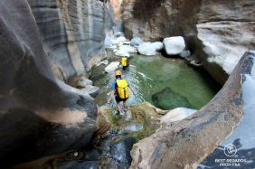 Wading through Snake Canyon, Oman