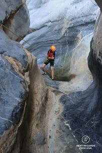 Rappelling down Snake Canyon, Oman