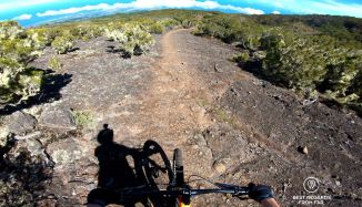 Mountain biking down the lava slab from the Maïdo, Reunion Island