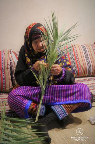 Elderly Omani woman in traditional clothes