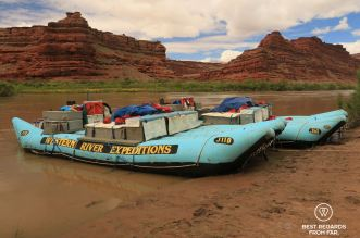 Western River Expeditions rafts anchored along the bank of the Colorado River during the Cataract Canyon rafting trip.