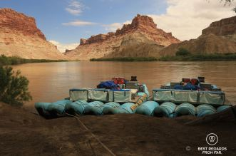 Western River Expeditions rafts stationed on the bank of the Colorado River just before Confluence.