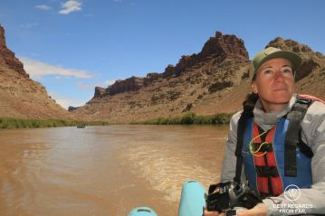 Photographer Claire Lessiau while rafting the Cataract Canyon section of the Colorado River.