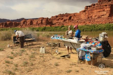 River guides preparing dinner on the bank of the Colorado River for the Cataract Canyon expeditions.