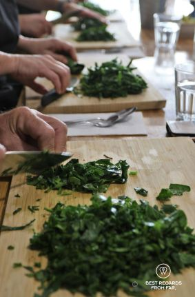 Cutting the spinach for the Spanakopita, The Greek Kitchen Athens, cooking class, Greece