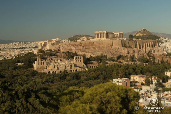 The Acropolis, old Greek buildings, green forest and blue skies, Athens.