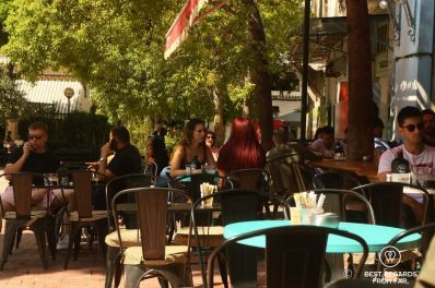 People having drinks on a sunny terrace in Athens, Greece