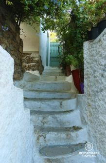 White staircase, and metal door in Anafiotika, Athens, Greece