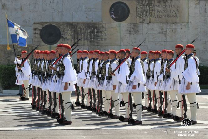 Military men dressed in traditional clothes and red barrets during the changing of the guards in Athens.