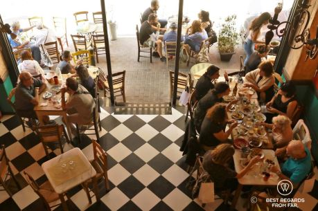 People having lunch in a local restaurant in Psiri, Athens, Greece