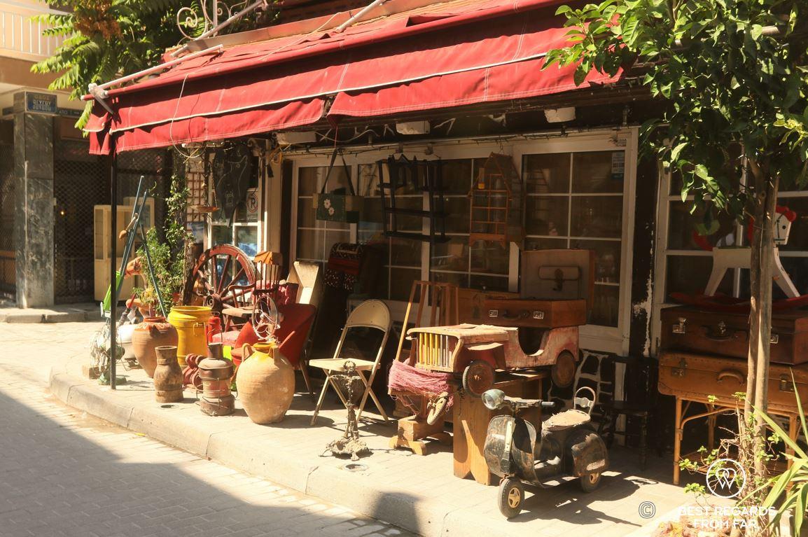 Flea market in the sun on a street cornder in Athens, Greece.