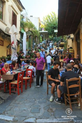 Busy street with people having drinks in Plaka, Athens, Greece.