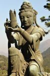 Statue with mountains at the background Lantau Island, Hong Kong.