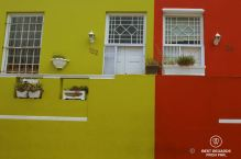 Contrasting olive green and bright red facades of typical architecture in Bo Kaap, Cape Town, South Africa