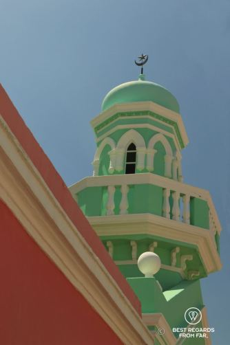 Green and white minaret contrasting with clear blue sky in Cape Town.