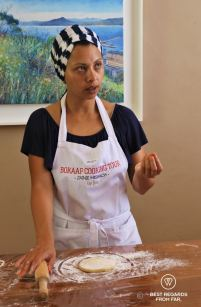Zoeffa revealing the secrets of a good rooti, Bo-Kaap cooking tour, Cape Town, South Africa
