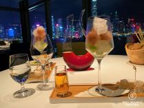 Drinks and dinner with a view on the lit high-rise buildings of Hong Kong Island at Cucina restaurant, Kowloon, Hong Kong