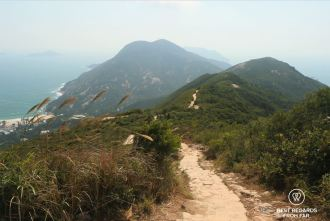 Dragon's Back hiking trail on Hong Kong Island with the mountains and the ocean