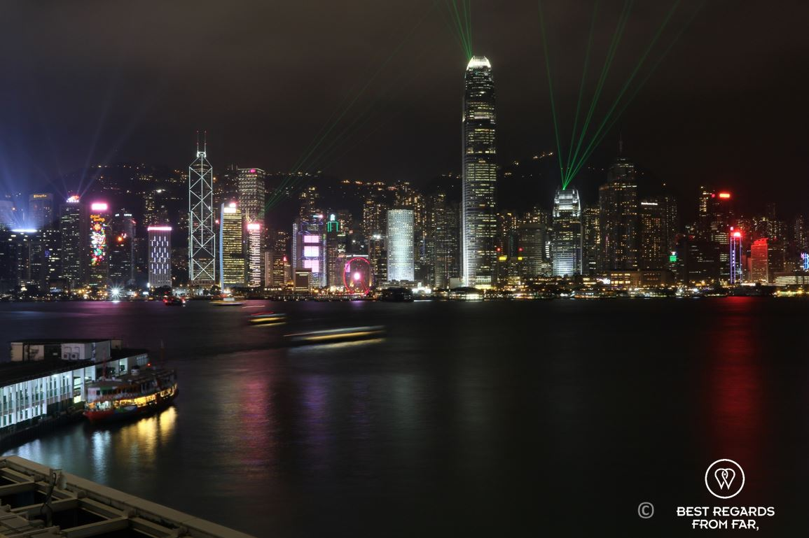 View from Cucina restaurant at night on the high-rise buildings of Hong Kong Island during the laser show, Kowloon, Hong Kong
