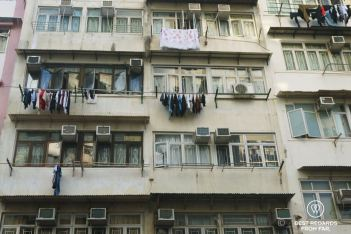 Precarious housing with laundry drying out the windows of poor buildings in Kowloon Hong Kong