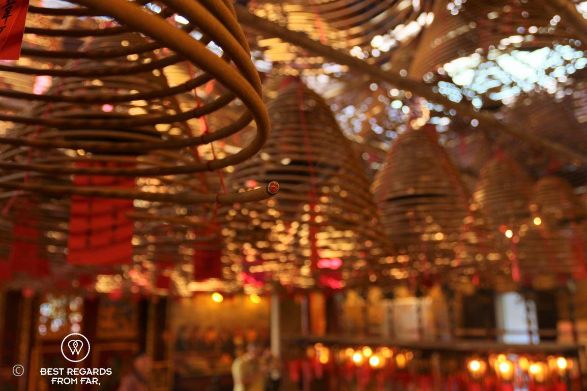 Close up of the spiraled-incense coils burning at Man Mo Temple on Hong Kong Island