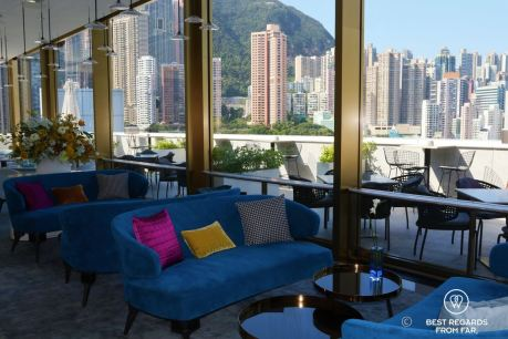 Stylish interior decoration of the Popinjays bar at the Murray Hotel, Hong Kong with Victoria Peak and high-rise buildings in the background