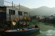 Blue boat and local houses on stilts, Tai O fishing village, Lantau Island, Hong Kong