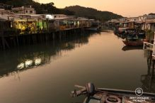 Water with authentic houses on stilts on bots sides at sunset in Tai O, Lantau Island, Hong Kong.