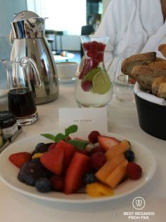 Room service breakfast with healthy fruits and fresh bread at The Murray luxurious hotel in Hong Kong