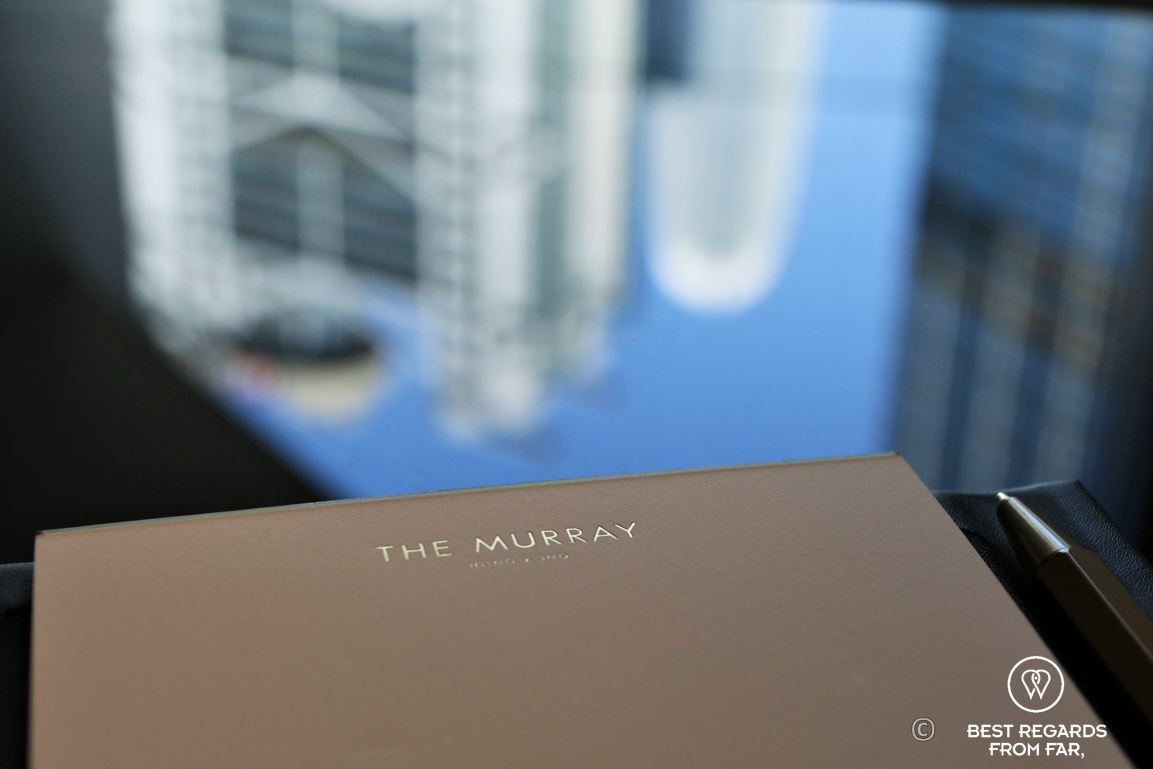Note pad of the Murray hotel in a room in golden letters with the HSBC tower in the background