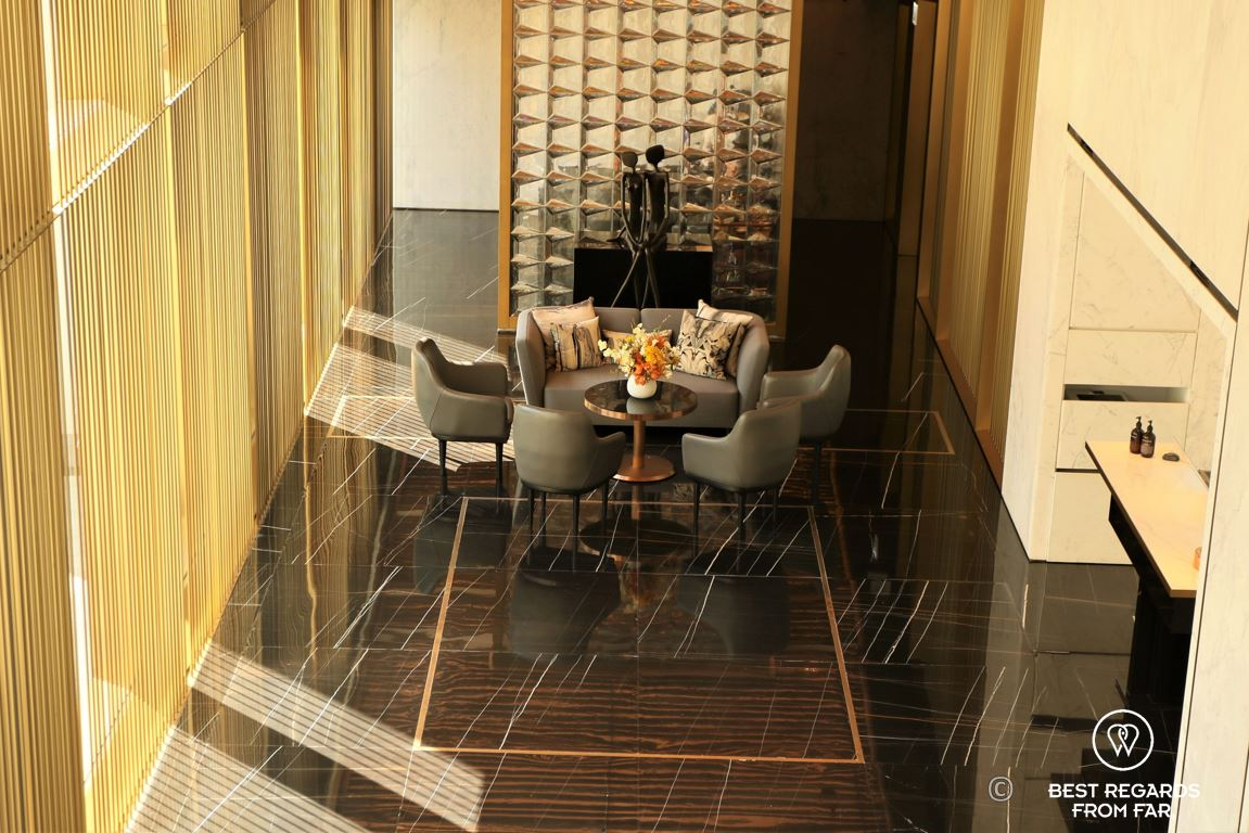 Marble and copper stylish golden lobby of The Murray luxurious hotel in Hong Kong