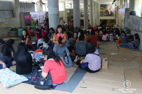 The precarious condition of domestic workers in Hong Kong relaxing underground on Sundays