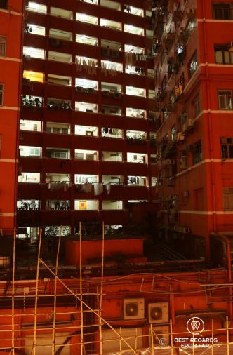Typical flats in Kowloon at night showing a high density of population in Hong Kong