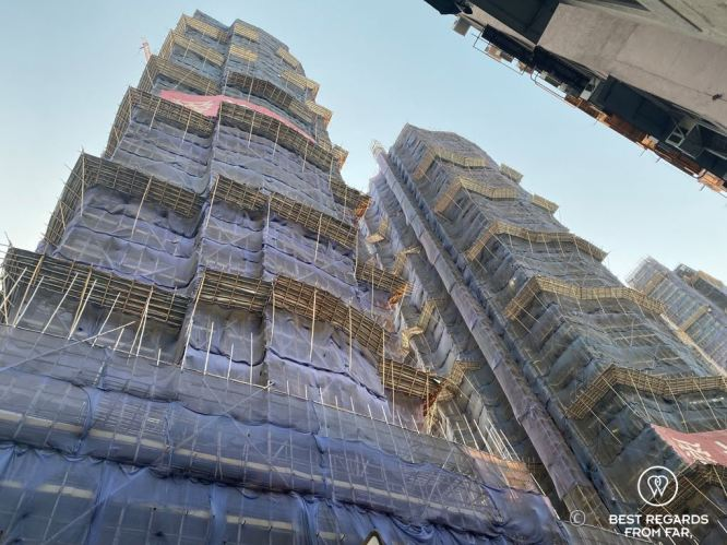 Bamboo scaffolding in Kowloon, Hong Kong while building new apartment buildings gentrification