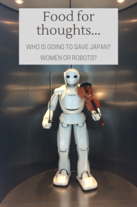 White robot with a violin in its hand in the Toyota Factory, Japan.