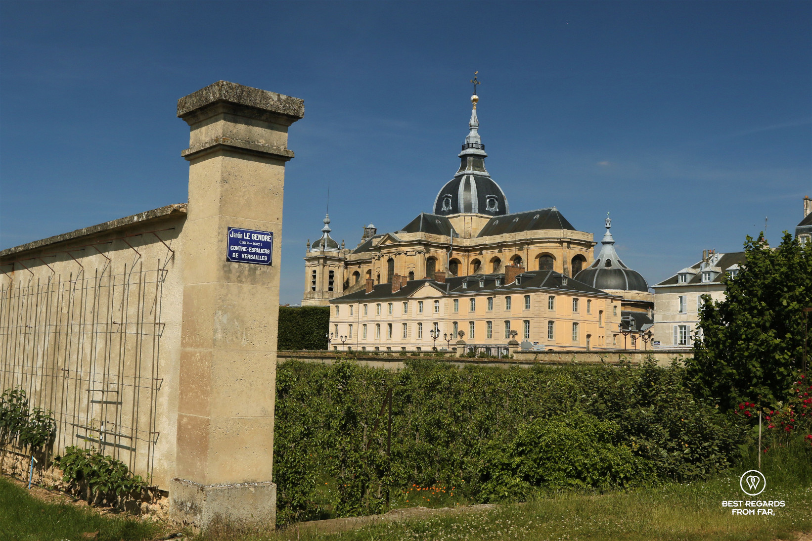 View of the King's Kitchen Garden in Versailles with the cathedral in the background.