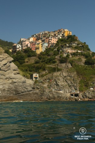 Colourful village built on a cliff above the sea