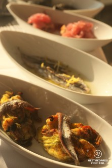 Close up of dishes with small anti pasti bites