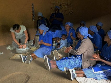 Grinding corn for flour with Basotho women in Eastern Lesotho