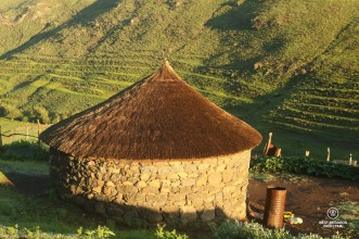 Traditional rondavel with its thatched roof in the village of Makhapung in Eastern Lesotho