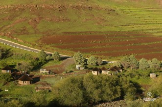 Bird's eye view on the homestay of the village of Makhapung in Eastern Lesotho with rondavels